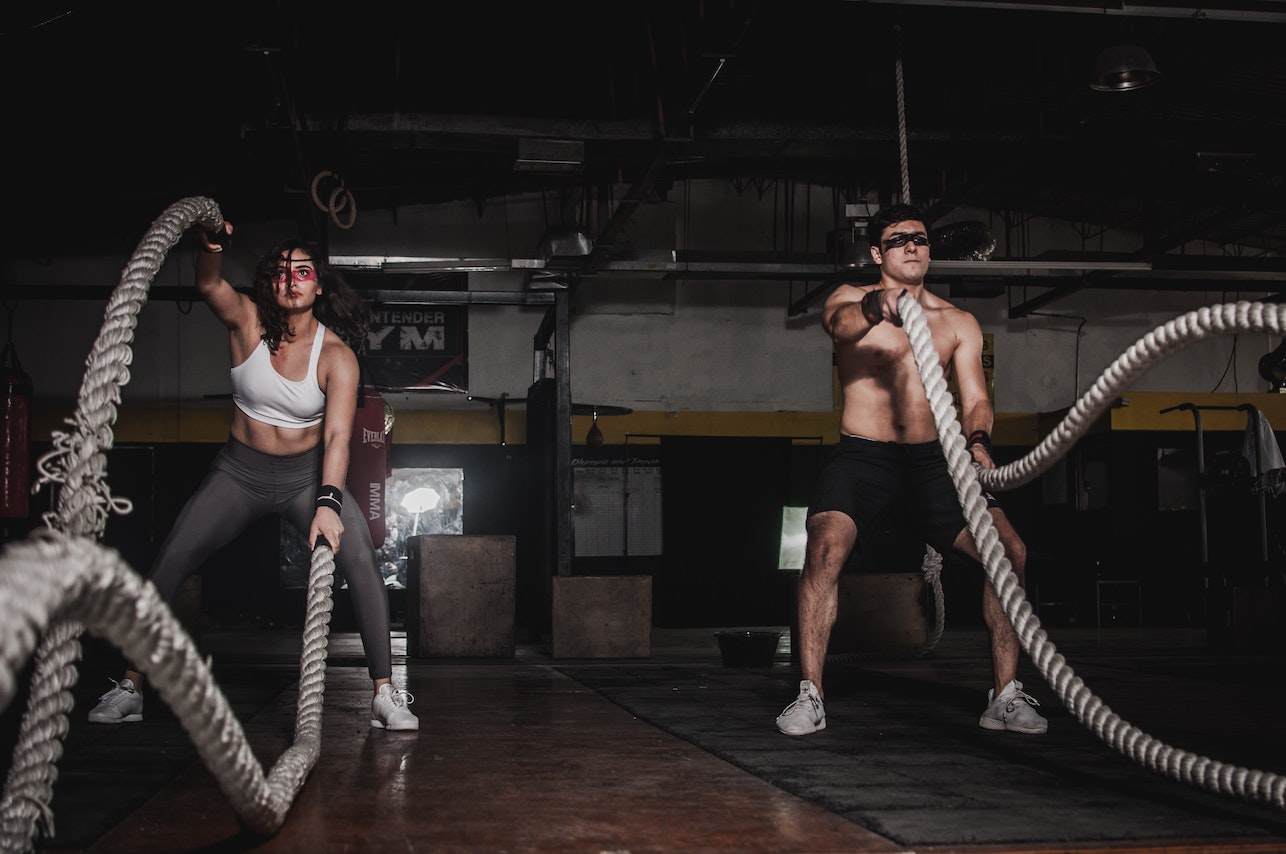 people exercising with ropes